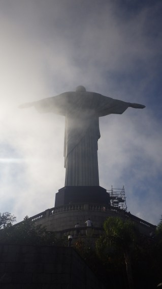 Christ stands high in the clouds over Rio