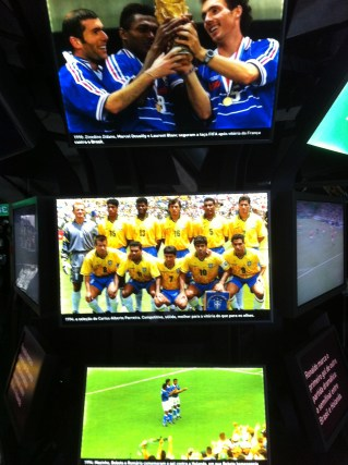 The winning Brazil team of '94, including the 'baby rocking' celebration by Bebeto, while France lift the '98 trophy