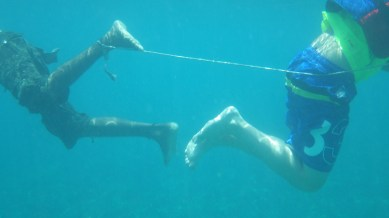 An artistic shot of two snorkelers trying to break their ties!