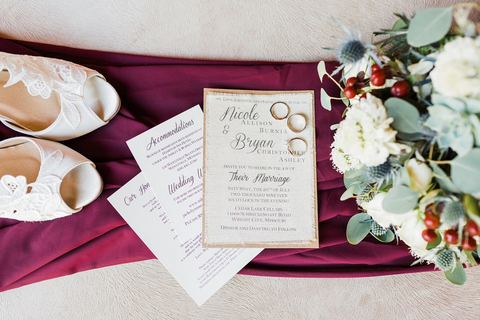Photo of the canvas invitation and burgundy wedding colors. Wedding venue, Cedar Lake Cellars, Photography by Jackelynn Noel Photography.