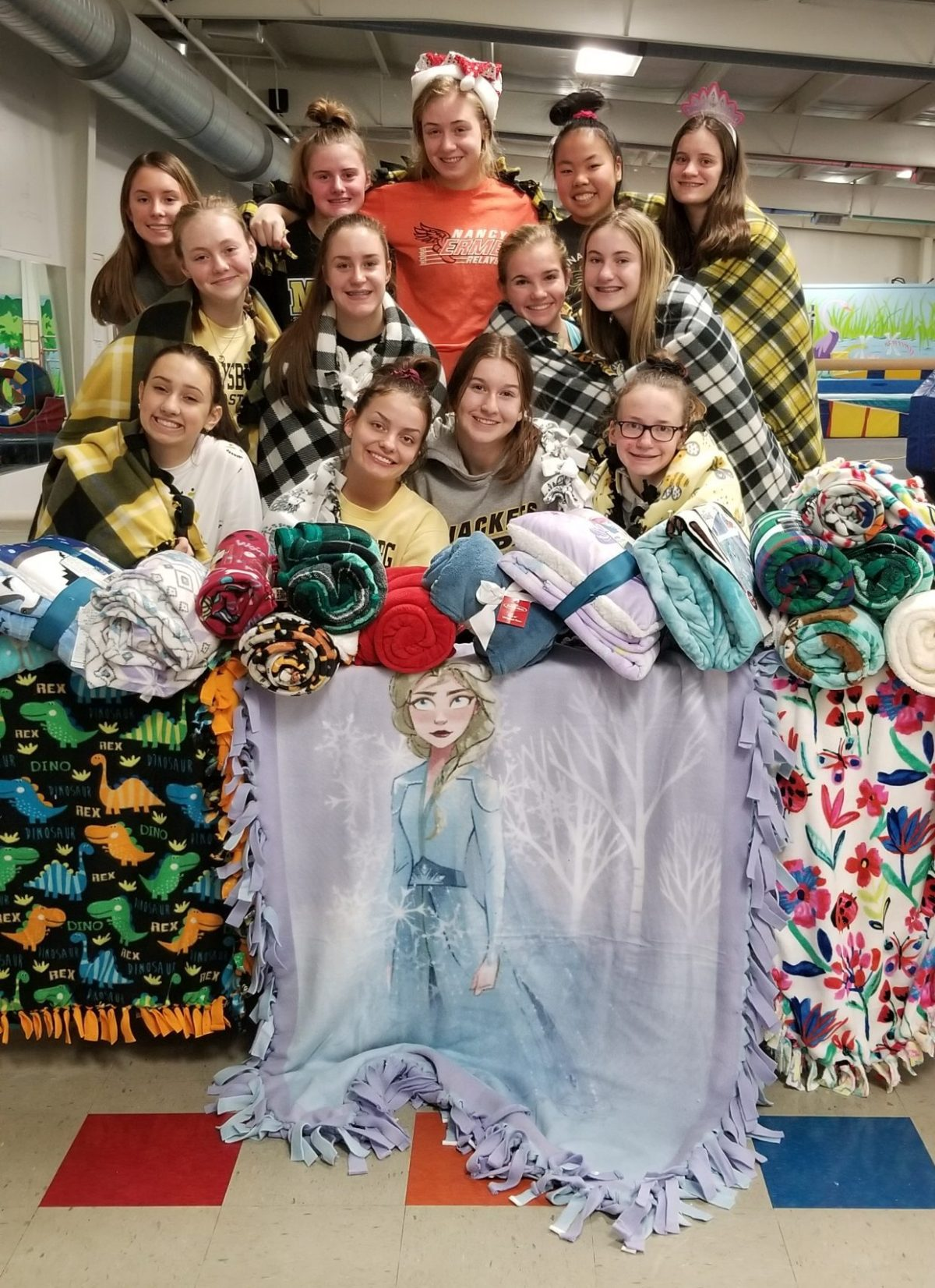 PHS Jacket Gymnasts helping with blanket making and food donations for the holidays…