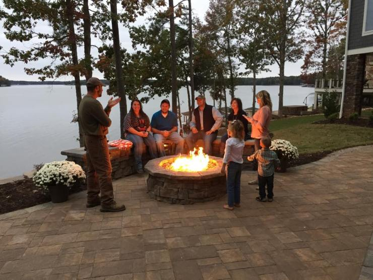 family spending time around the fire pit