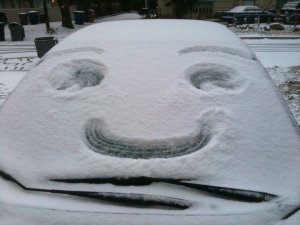 snowy smile face on windshield