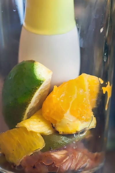 muddled grilled fruit in a glass