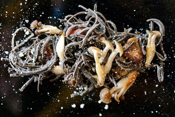 spooky black pasta carbonara with mushrooms and cheese