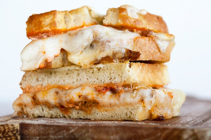 lasagna grilled cheese sandwich with melted cheese crust on Italian bread with sausage,
