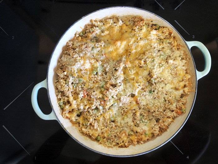 Tuna noodle casserole in a La Creuset braiser topped with cheese