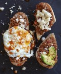 molletes with egg, queso fresco, beans avocado and hot sauce