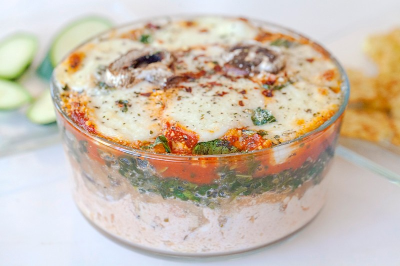 layers of cheese, spinach, mushrooms and lasagna flavored tomato sauce in a warm spreadable dip.