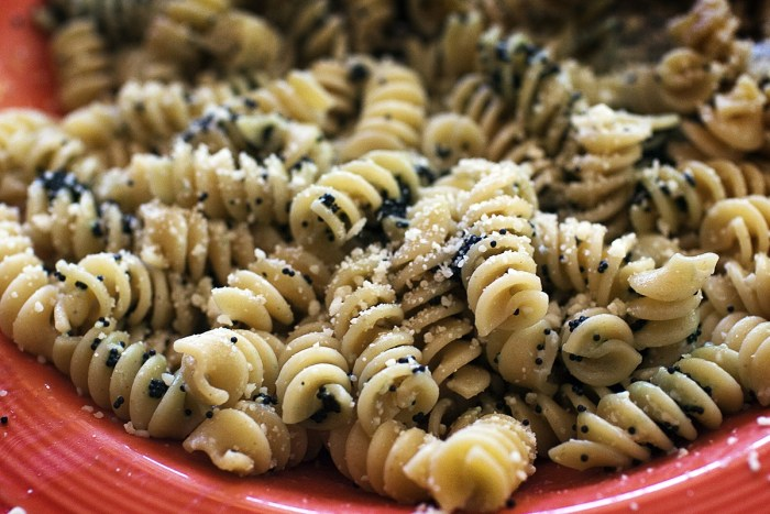 rotini mixed with with caviar and Parmesan cheese