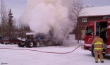 Smoking truck with engine on fire