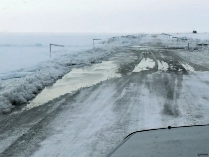 Coming from Prudhoe, the Sag River runs along the Dalton Highway on the left and as you can see it has overflowed its banks. The State has come through and plowed to create a berm but that's not stopping it. (Jack is driving south.)