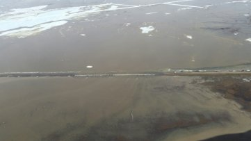 On the top of the photo are more berms that were created to direct the water away from the road. From AK DOT webpage.