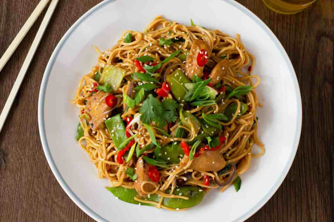 A photo of my Chicken Stir-Fry with Noodles recipe with chop sticks in the background
