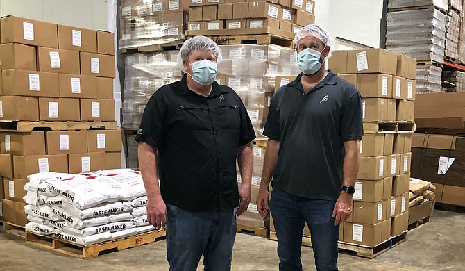 Jeffrey Reed (left) and Justin Reed (right), sons of original owner R.J. Reed,  presently own and operate their father's spice- and sauce-blending business. Photo courtesy Reed Food Technology