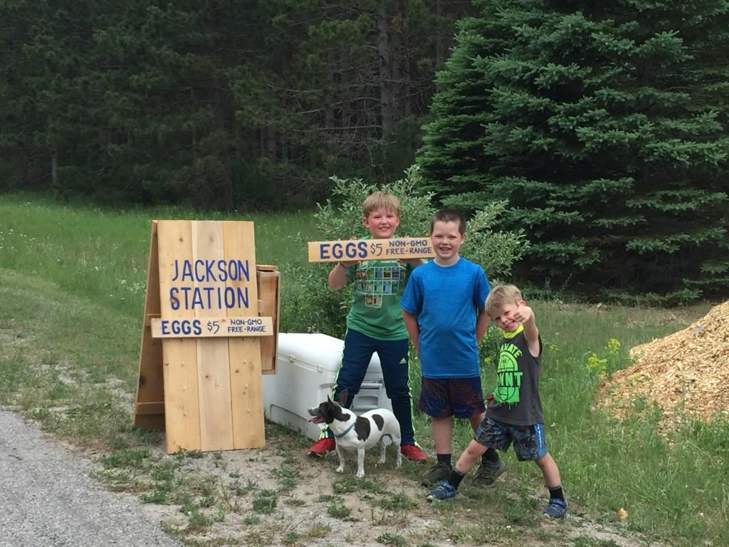 kids at roadside farm stand