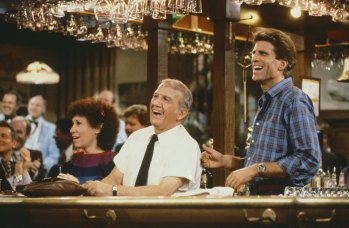 "CHEERS -- ""Friends, Romans & Accountants"" Episode 7 -- Pictured: (l-r) Rhea Perlman as Carla Tortelli, Nicholas Colasanto as Ernie 'Coach' Pantusso, Ted Danson as Sam Malone-- Photo by: Paul Drinkwater/NBCU Photo Bank"