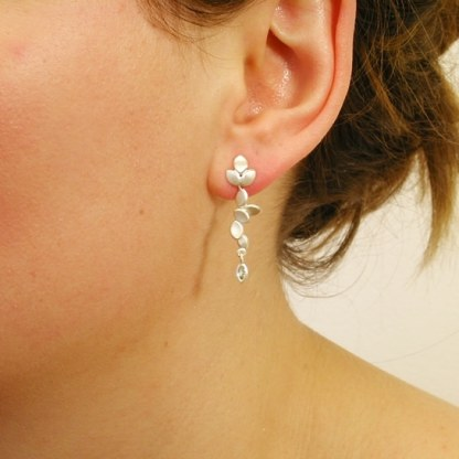 contemporary modern designer handmade bespoke wedding jewellery silver long drop earrings with marquise green sapphire EveE3-G:Sapp marq-sil on model