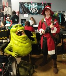 Myself as a Red Mage from Final Fantasy posing with a proton pack and Slimer, courtesy of the Western Kentucky Ghostbusters