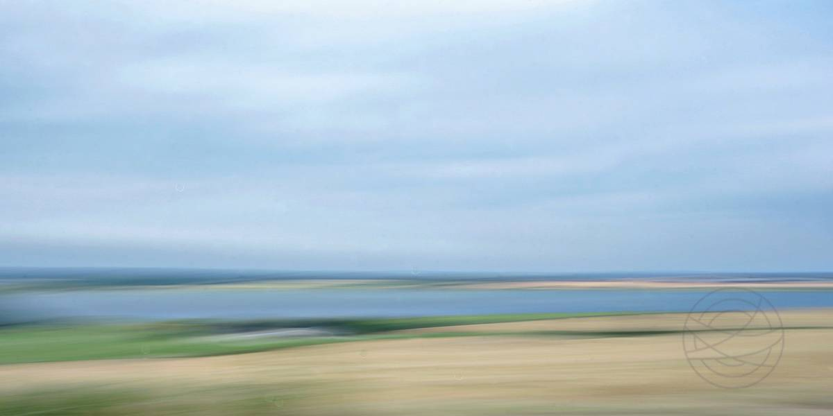 Windswept Memories - View over the fields and a lake in North Jutland on a windy summer day. - Abstract realistic fine art landscape photography by Jacob Berghoef