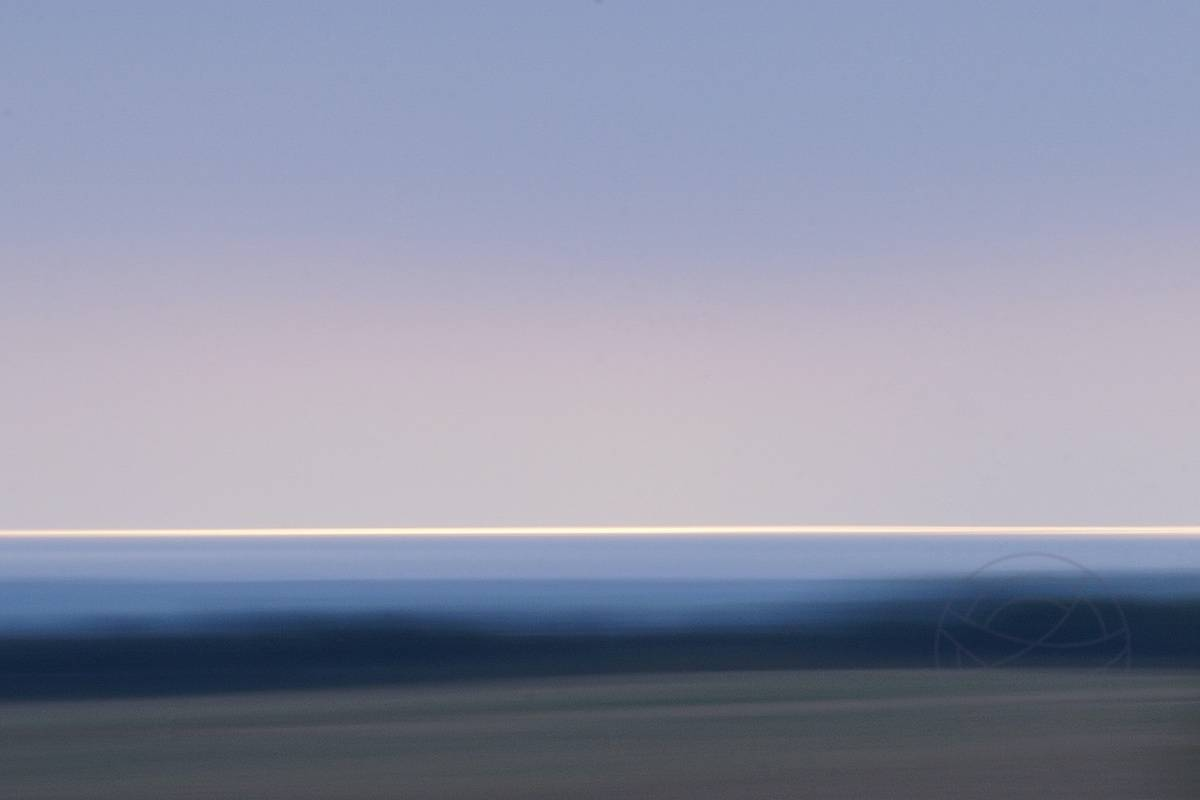 Fragile Promise - An intense gray rainy summer's day, a day like it can actually occur here all year round. But then, a few hours before sunset, a bright stripe appears on the horizon. - Abstract realistic fine art landscape photography by Jacob Berghoef