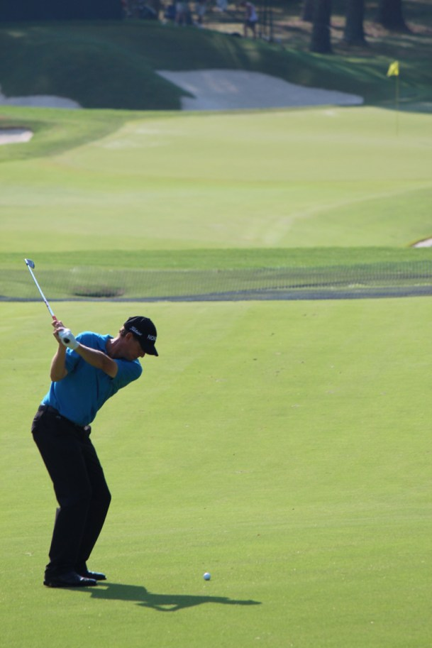 A golfer takes a shot down the fairway in the 2011 PGA Championship.
