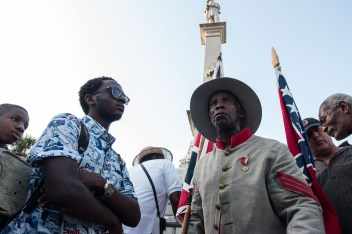 Protestors face off aat the South Carolina statehouse on the final day the Confederate flag flew on the grounds.