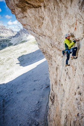 "Climbing on the first choosy pitches of ""Pan Aroma"", Tre Cime"
