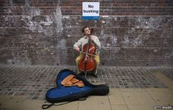 _75969408_no-busking-sign_getty