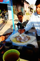 Eating Chapati with sugar, eggs and chocolate
