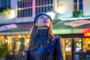 asian woman in city at night photo by Jacques Julien