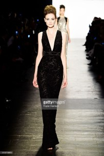A model walks the runway wearing Carmen Marc Valvo Fall 2016 during New York Fashion Week: The Shows at The Arc, Skylight at Moynihan Station on February 16, 2016 in New York City.