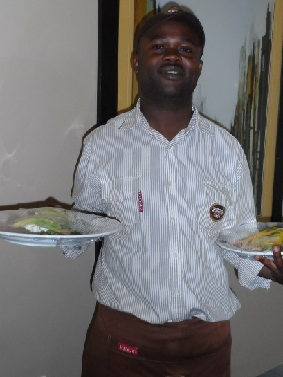 Isaac delivering lunch for the execs