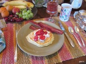 Strawberry pancakes, bacon and fresh fruit