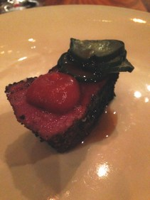 Wagyu pastrami, cucumber and tomato pickle, onion jus