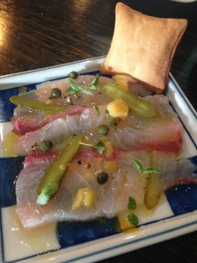 Kingfish carpaccio and citrus ice