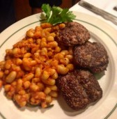 Tuscan sausage with white beans in tomato sauce