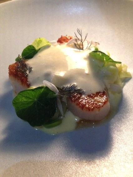 Seared sea scallops, spring vegetables, crème fraiche emulsion, lemon jam, herbs, flowers