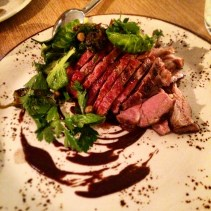 Coal roasted young lamb with Brussel sprouts and black garlic