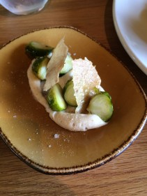 Brussel sprouts cooked in chicken fat, cauliflower puree and chicken skin