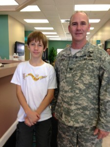 River Kidz member Brandon Collins and ACOE Col. Alan Dodd at a Rivers Coalition meeting in 2013. (Photo JTL)