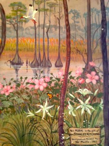 Western Martin County used to be full of Cypress tress around and beyond Lake Okeechobee. This part of the mural shows cypress trees, lilies and native hibiscus.