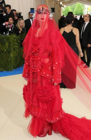 Who is she? And what is she wearing?? Sorry Katy Perry, but all I see is RED!