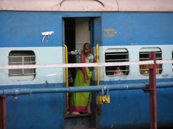 woman catching a train in Mumbai, India, image by Jade Jackson