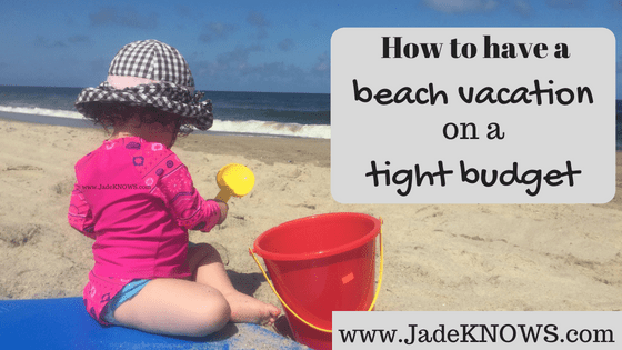 "Toddler girl plays with a pail and shovel on the beach, with text nearby that says, ""How to have a beach vacation on a tight budget"" and ""www.JadeKNOWS.com."""