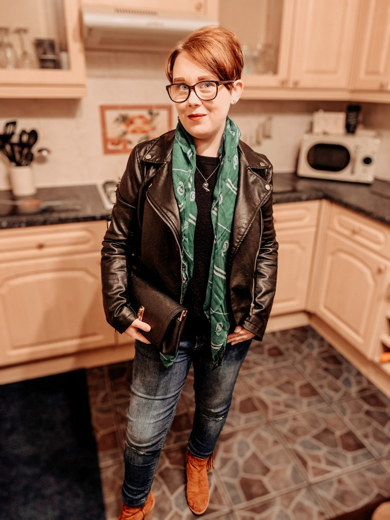 Jade Marie on Christmas Day 2020. Blue jeans, black leather jacket, brown boots, black jumper and Slytherin scarf