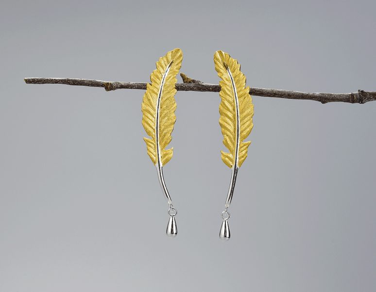 https://www.lotusfun.com/products/vintage-feather-earring