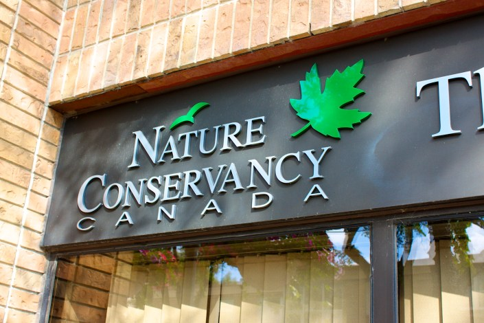 nature conservancy lettering sign