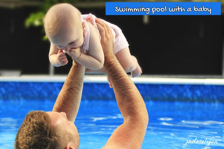 Baby in France doing swimming pool activities