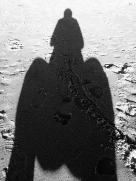 Squatting on the beach.